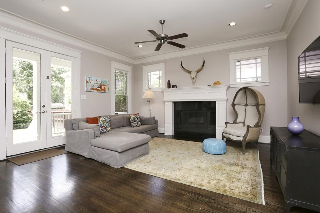 Informal Living Room That Features French Doors That Lead To The Large Back Porch Yard A Gas