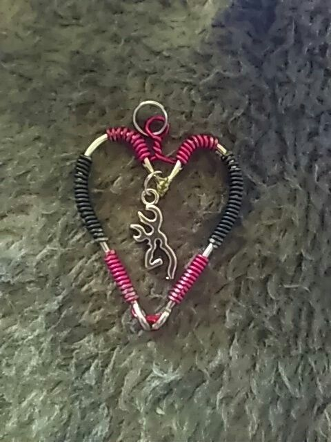 Red / black fish hook heart w browning buck charm pendant. Get yours today at Country Gals Hooked on facebook 10$ for necklace and 20$ for necklace w matching earring. Add matching bracelet for 10$