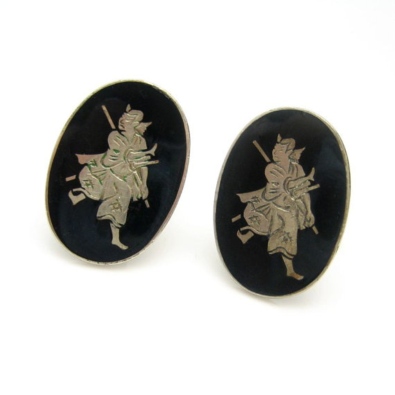 STRIKING SAMURAI CUFFLINKS! A great gift for him - large oval cufflinks with engraved Samurai swordsmen on a black enamel background. $56.50. See More Vintage Men's Jewelry in My Shop: https://www.etsy.com/shop/MyClassicJewelry?section_id=13248426