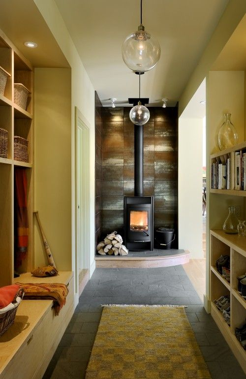 Mudroom with fireplace and awesome globe chandeliers.