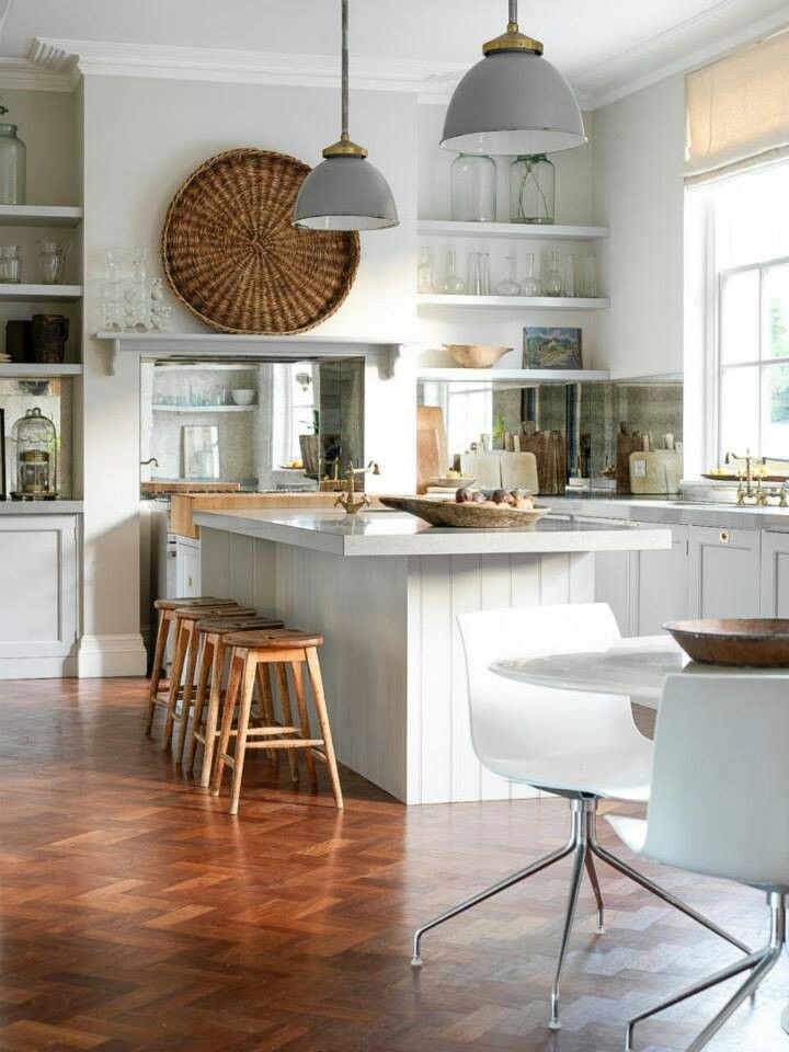 White kitchen with #mirror splash back, #industrial style #pendant lights. Love the handmade touches.