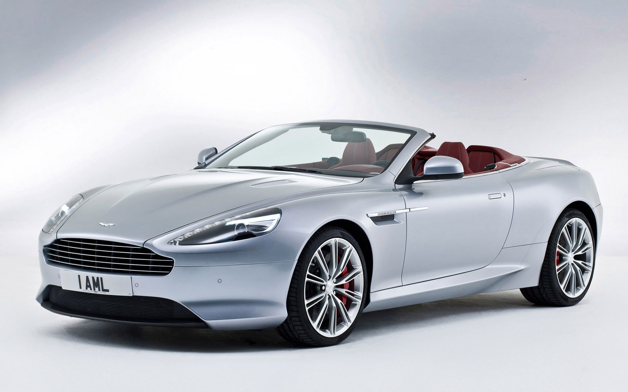 The 2013 aston martin is available as a coupe or convertible soft top known as the volante the coupe