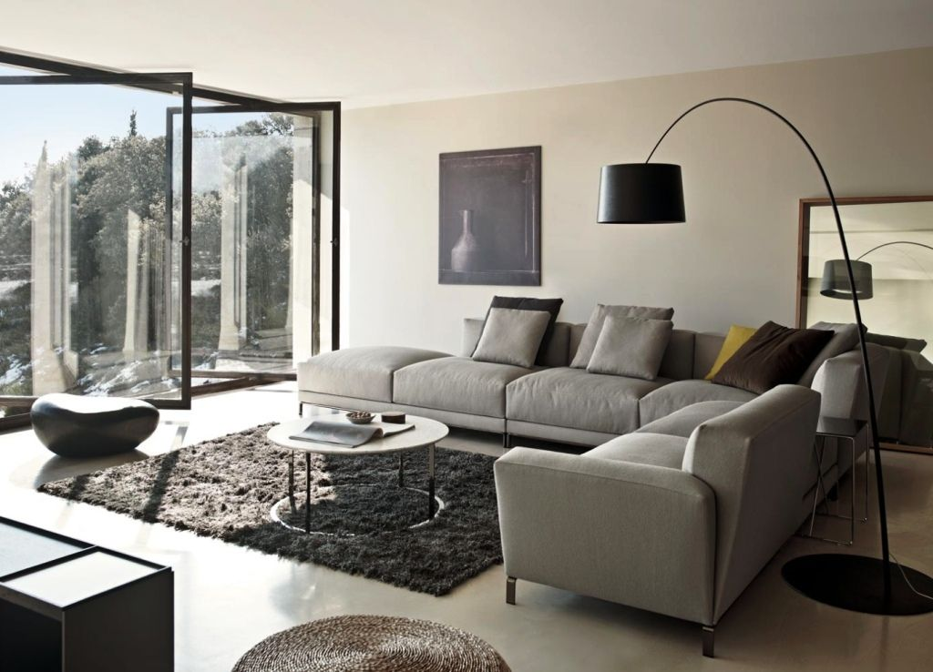 living room l shaped couch overstuffed gray color with standing lamp black and large windows