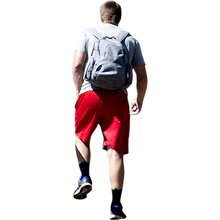 A man carrying a heavy backpack is huffing and puffing up