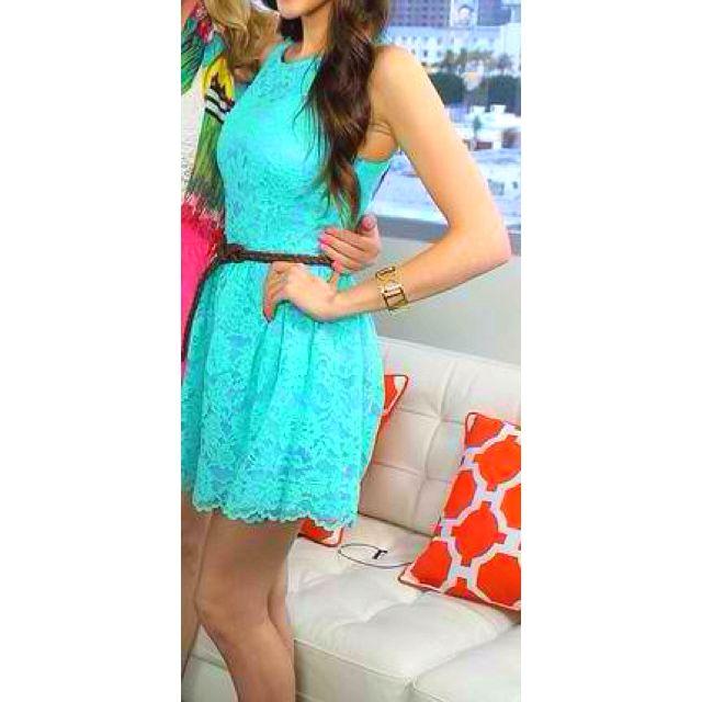 Aqua lace dress with a brown belt.. So cute.