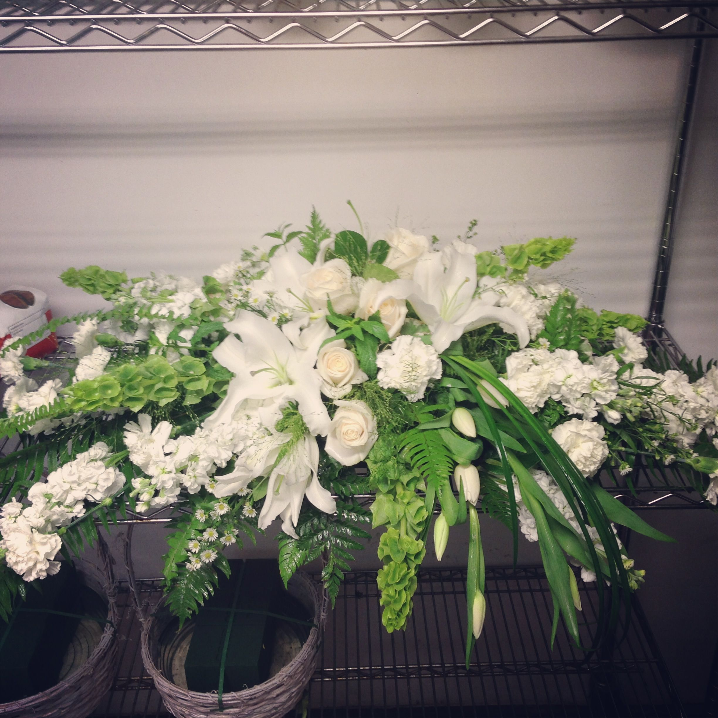 Casket Spray With Oriental Lilies Bells Of Ireland Roses Tulips Carnations Stock And Lily Grass Funeral Flowers Casket Flowers Funeral Floral