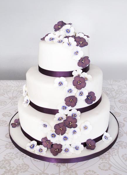 Wedding Cake With Purple Flowers 434x596