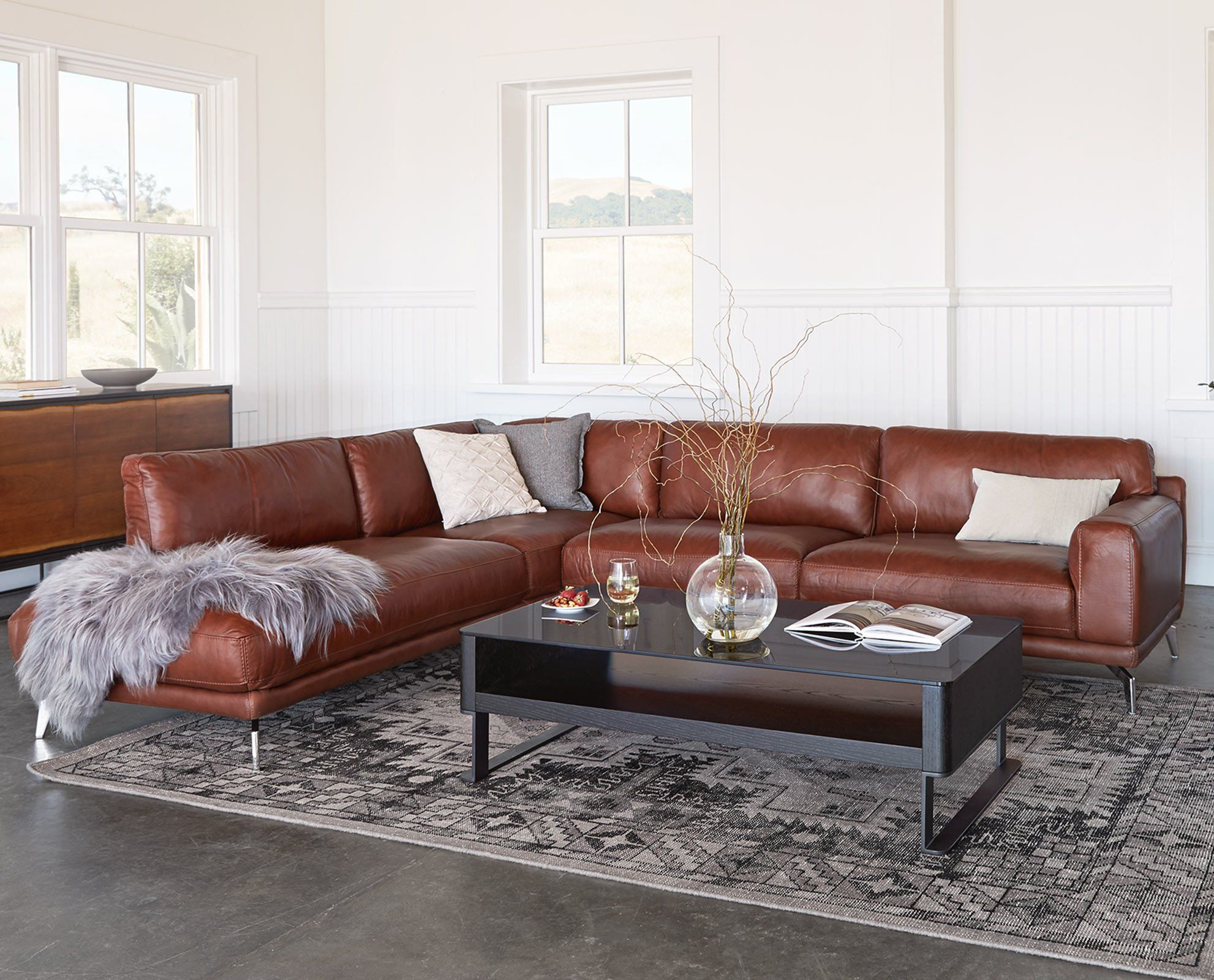 Peruna leather sectional left chaise from dania furniture - Overstuffed leather sofa living room ...