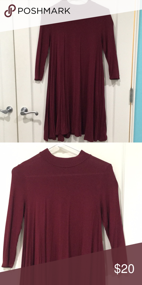 a1549d3e1b21 Reddish maroon high neck dress This loose fitting dress has a high neck. It  looks great with high boots and big pieces of jewelry. Rolla Coster Dresses