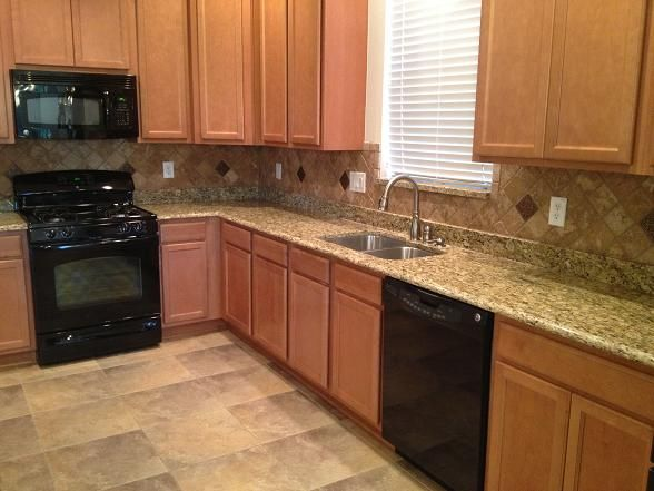 Diagonal Tumbled Travertine Backsplash Installation In