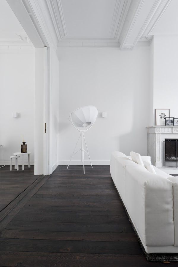 White Minimal Decor Dark Wood Floors White Sofa And Crown Moldings Dark Wood Floors Living Room Brown Living Room Decor Living Room Wood Floor