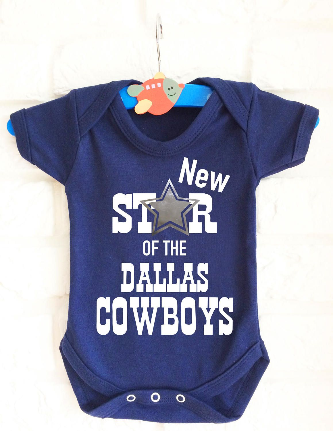 76ce4b51fc168 American football Dallas Cowboys inspired baby's blue baby grow onesie  bodysuit. Very cute :) by MumKnowsBabyGrows on Etsy