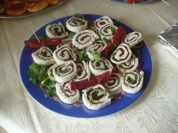 rolled sandwiches with bresaola and rocket leaves