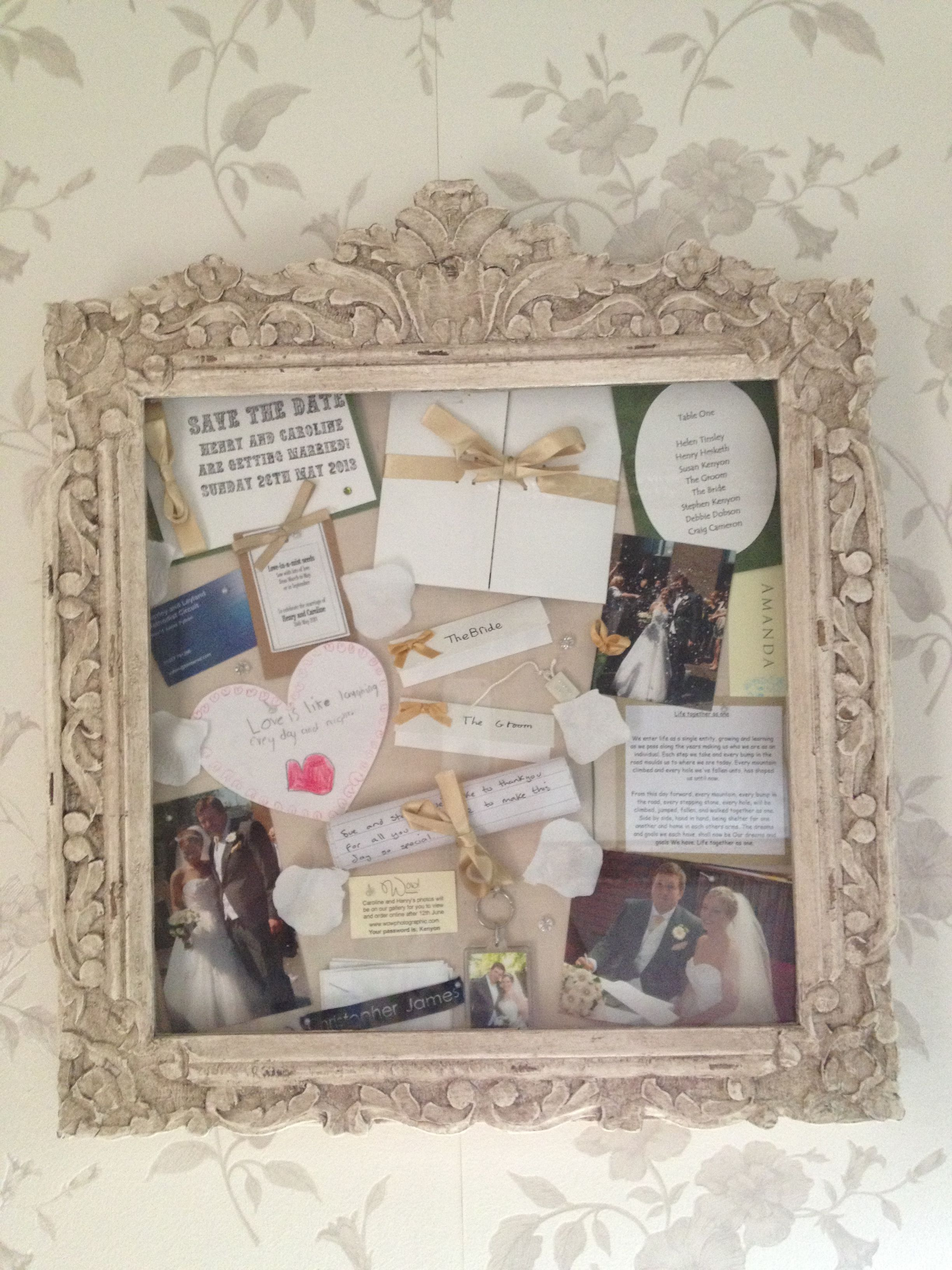 Box frame with wedding memories invitations dress label tiara