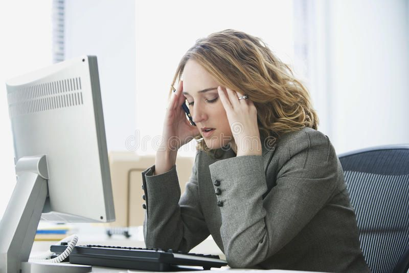 Stressed Businesswoman Working In Office A Young Businesswoman Is