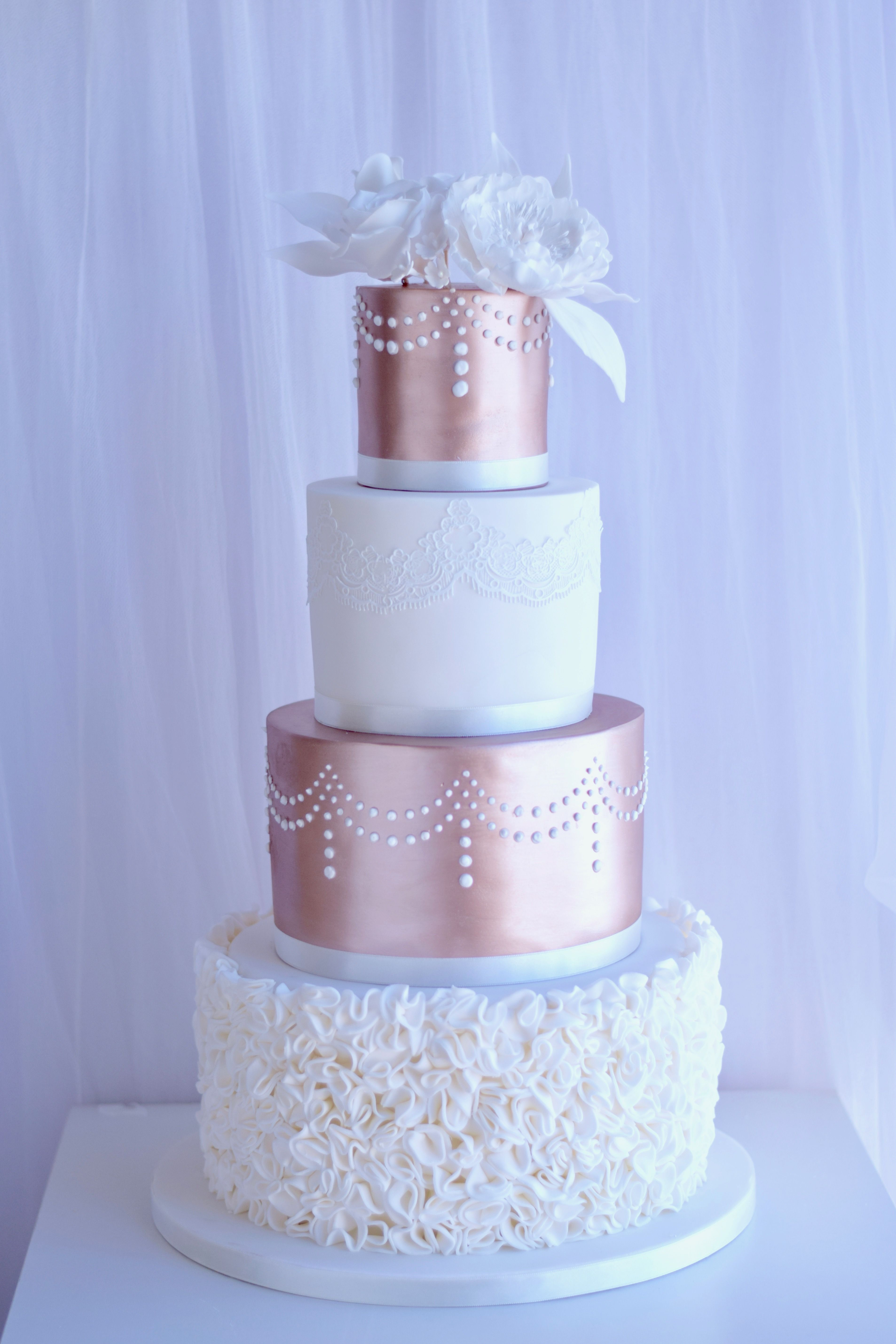 Elegant 4 Tier Rose Gold Wedding Cake With Ruffles And Sugar
