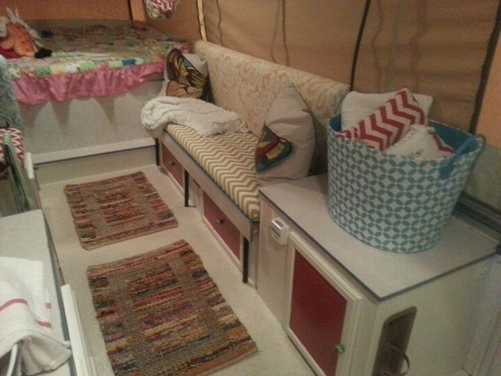 Pop up camper redo  sofa area   painted cabinetry  added braided rugs. Our pop up camper bed redo    Our Glamping Adventures   Pinterest