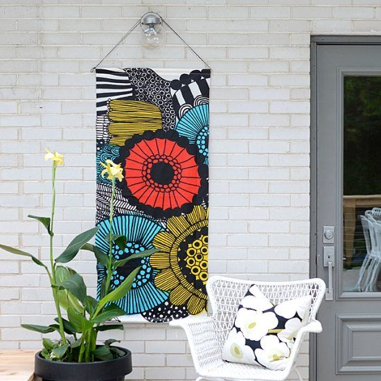 An Easy Diy For A Boring Apartment: Give A Boring Outdoor Wall Some Life With This DIY Art. It