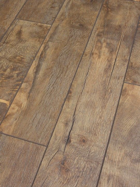Dezign stone canyon distressed oak laminate flooring for Laminate wood flooring ideas