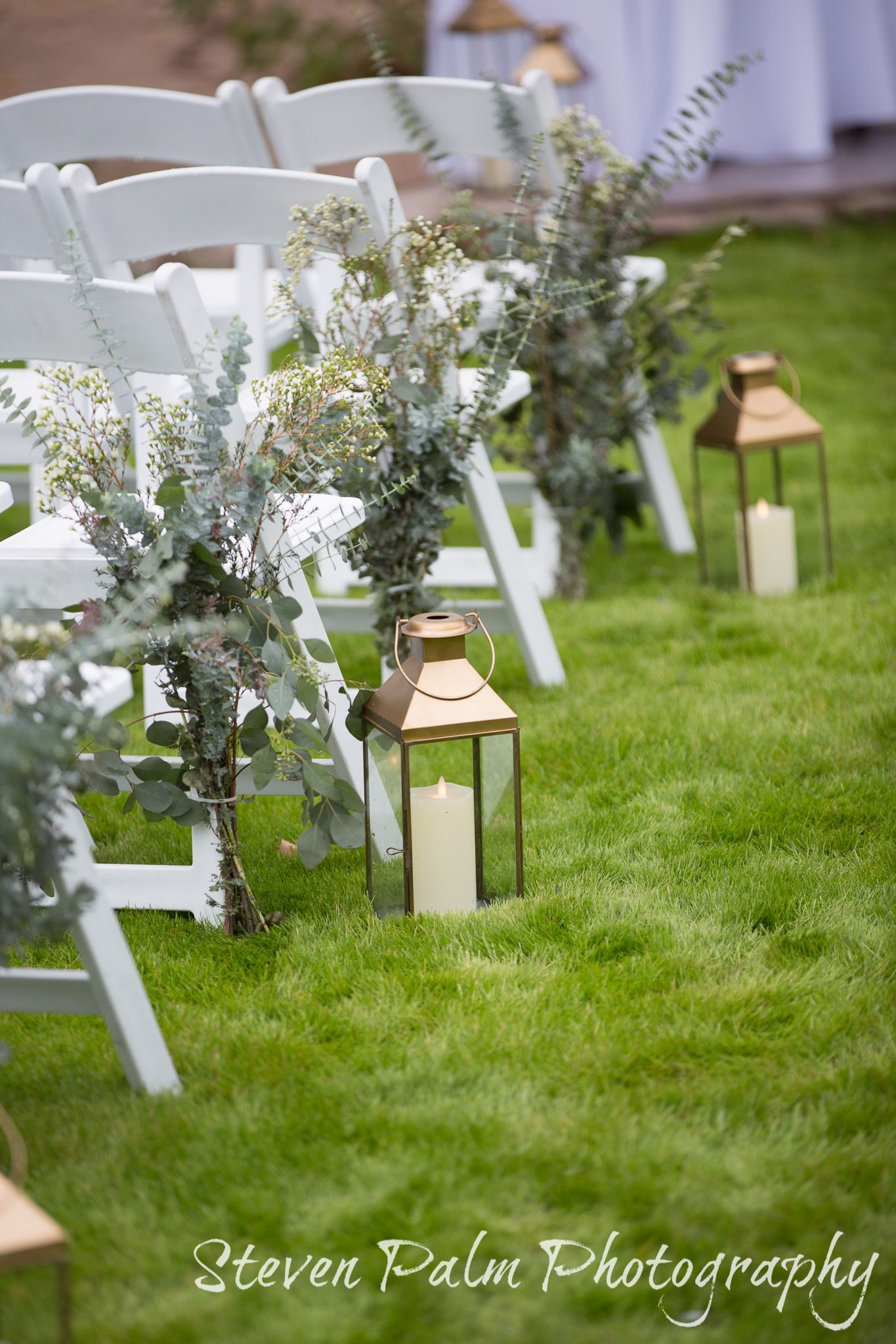 Simple Organic Ceremony Aisle Decor With Lanterns And Greens