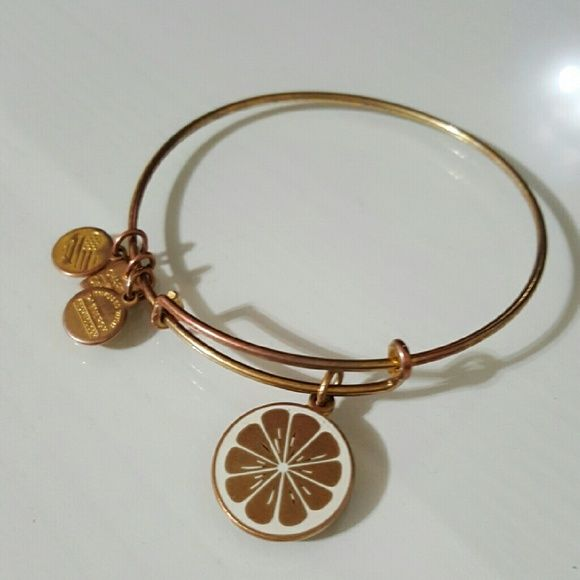 Alex & Ani Zest For Life Bangle - Gold Bracelet does have some wear.  Energetic - Bright - Confident  Tart and vibrant, the lemon has ancient roots and possesses a distinct flavor with a bold, cheerful color. Its fresh citrus scent is associated with cleansing, symbolic of an opportunity to make a change. This charm is a reminder that when life hands you lemons, you have the power to take positive action, sweeten the situation, and make lemonade. The power to create a desirable outcome is…