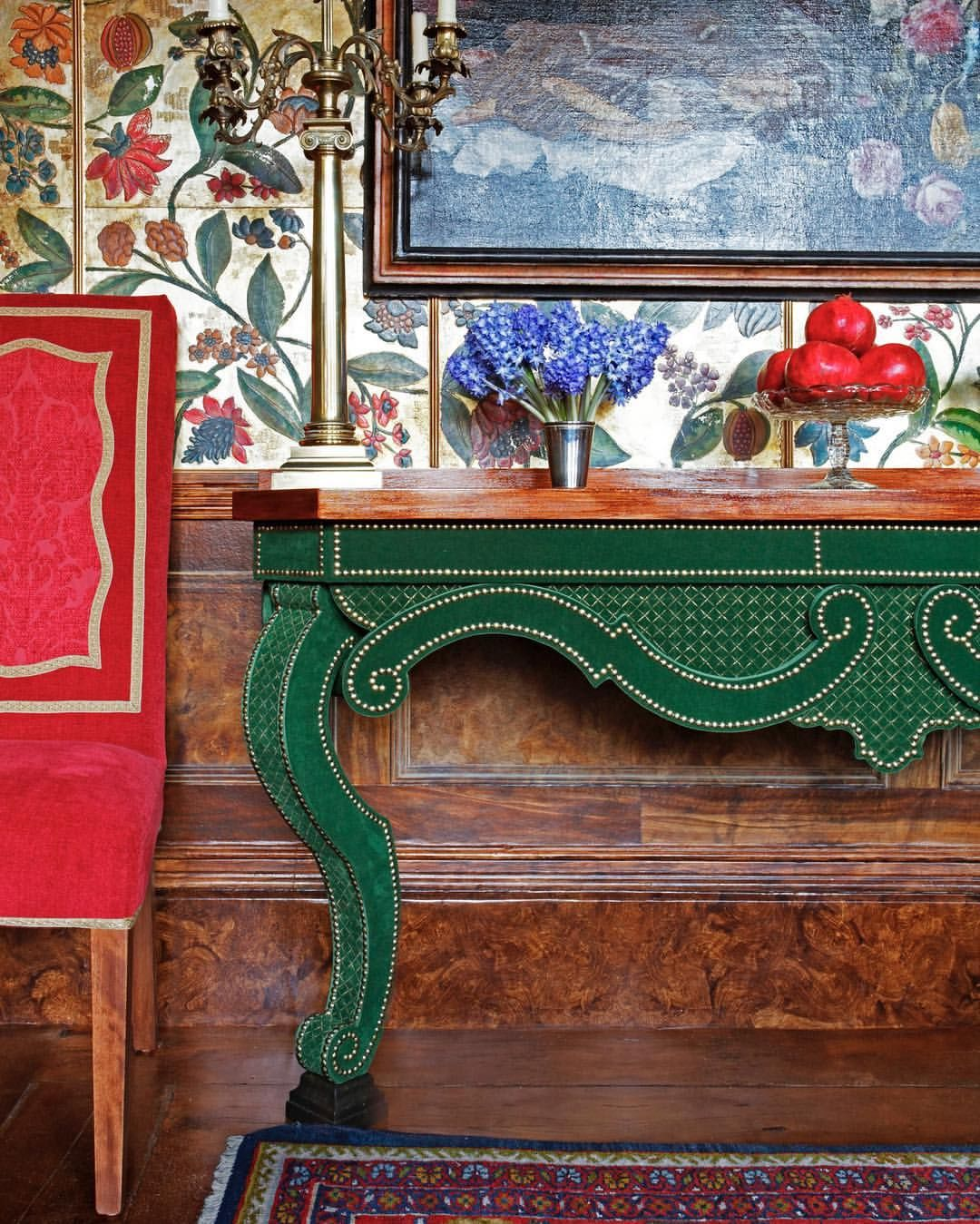 Red and green perfection in the dining room featuring embossed leather walls and an augustus console table photo by james mcdonald