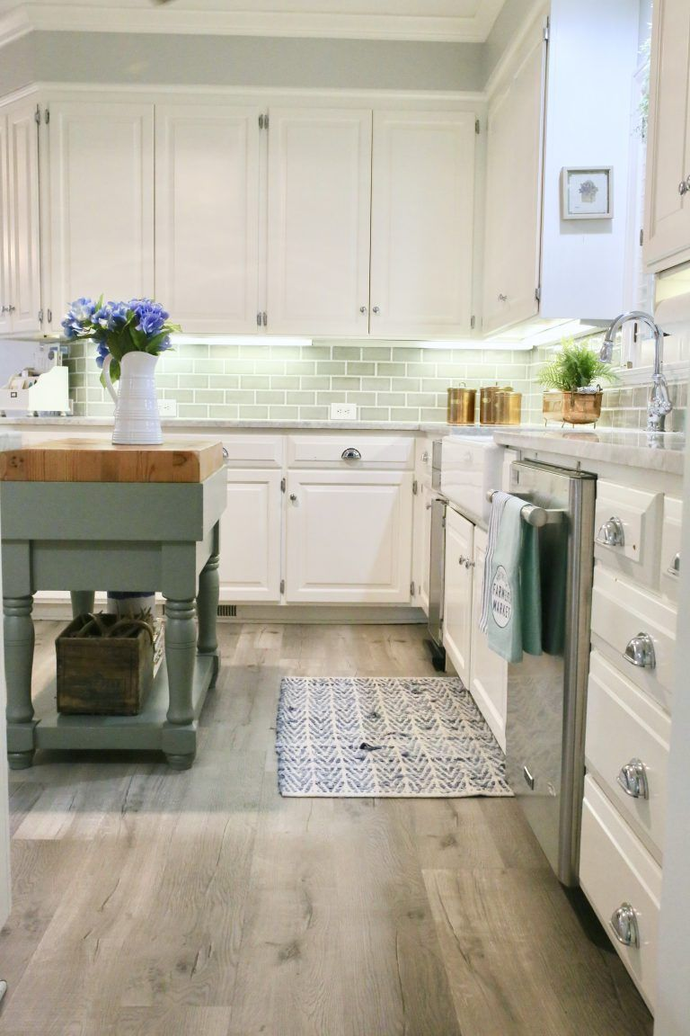 updating a kitchen with vinyl engineered plank flooring cutertudor vinyl flooring kitchen on kitchen remodel vinyl flooring id=47599