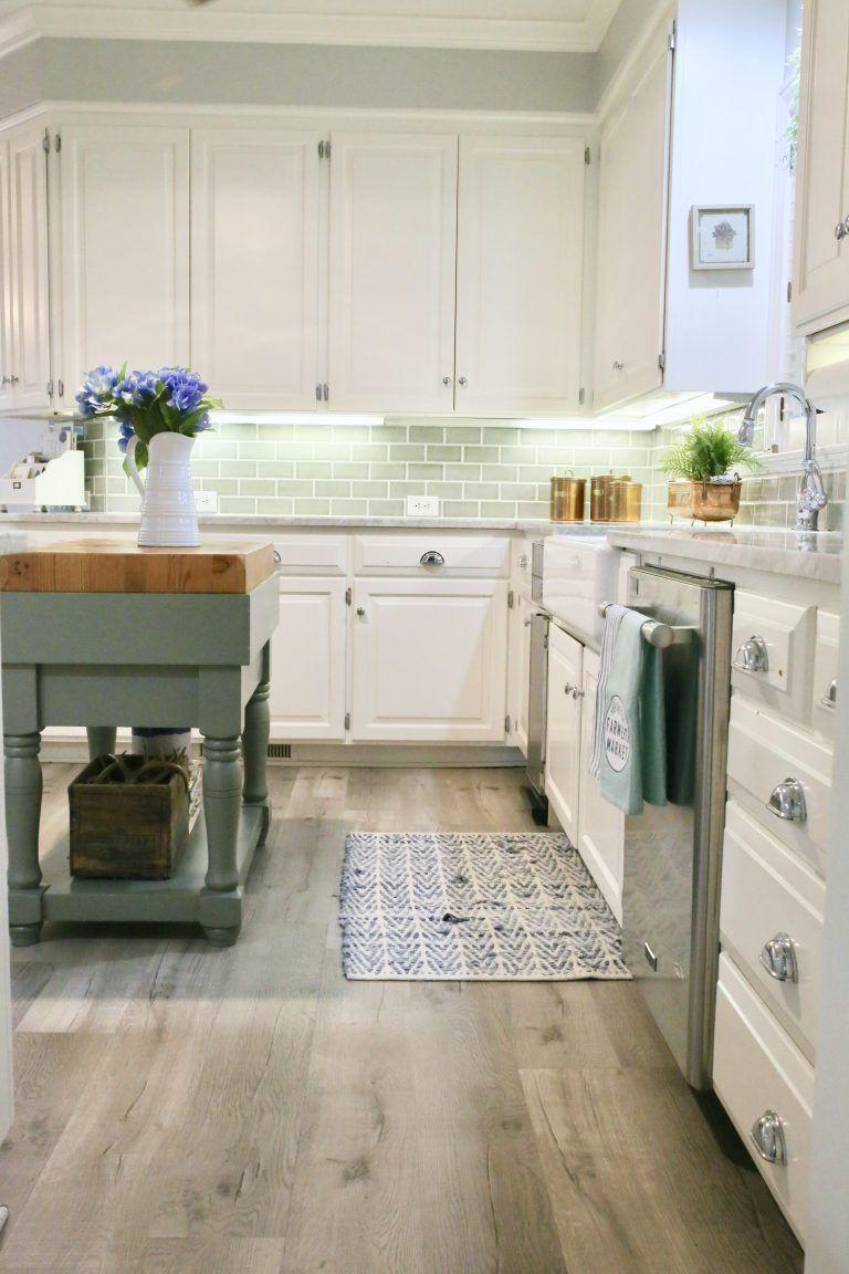 updating a kitchen with vinyl engineered plank flooring cutertudor vinyl flooring kitchen on kitchen remodel vinyl flooring id=47599