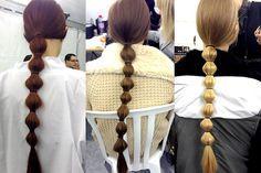 Superlong, segmented ponytails at Valentino fall 2014