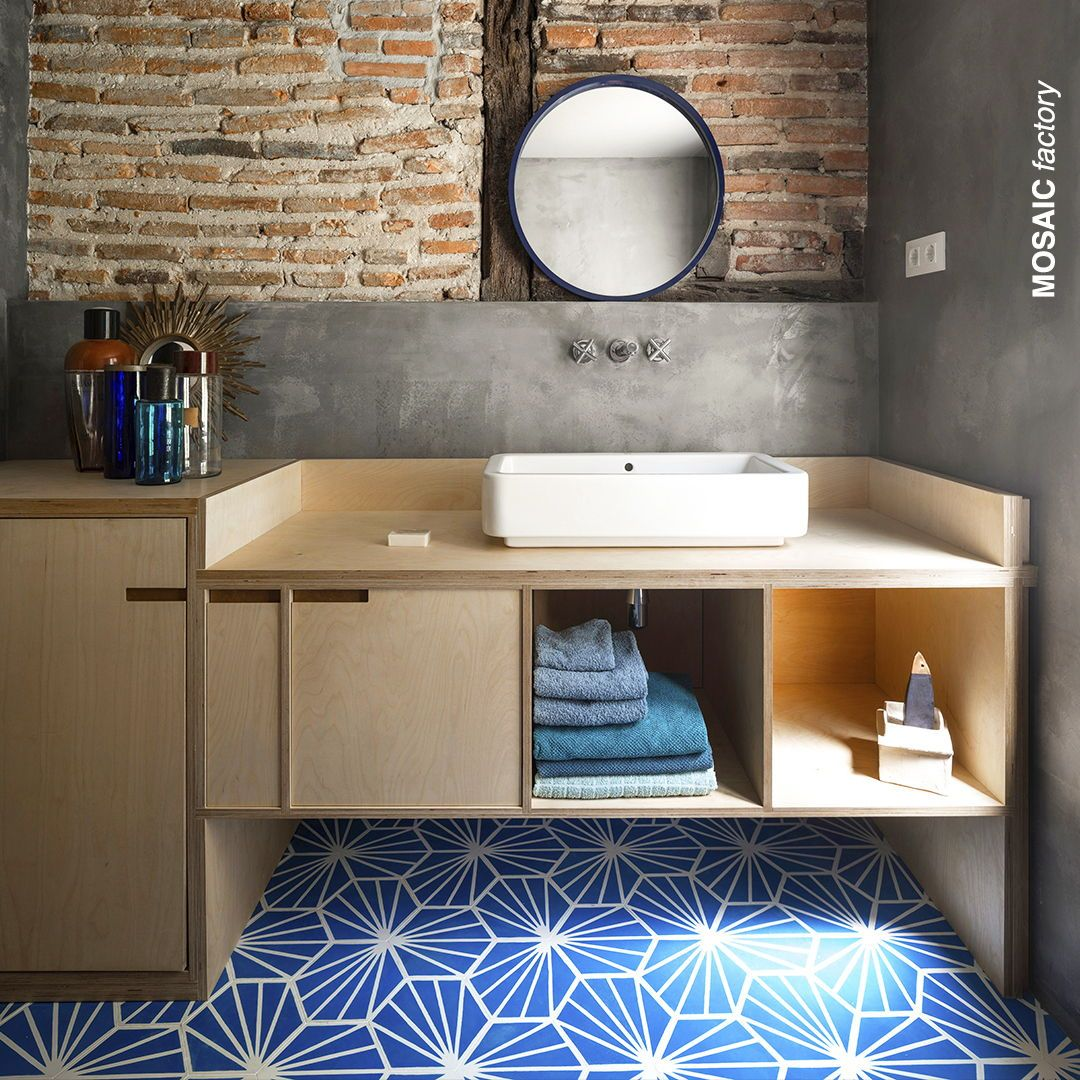 Modern Rustic Industrial Bathroom With Statement Floor In Bright Blue And White Hexagon Cement Tiles From Mosai Tile Bathroom Blue Interior Design Blue Tiles