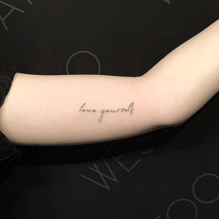 """Love Yourself"" Tattoo On The Left Inner Arm."
