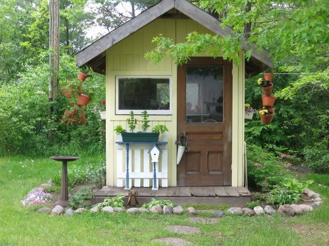 Garden Shed with Hanging Tipsy Pots by snowbunny