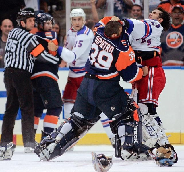 New York Islanders Goalie Rick Dipietro 39 And New York Rangers Goalie Al Montoya Fight As Islanders Freddy Hockey Fights New York Islanders Rangers Hockey