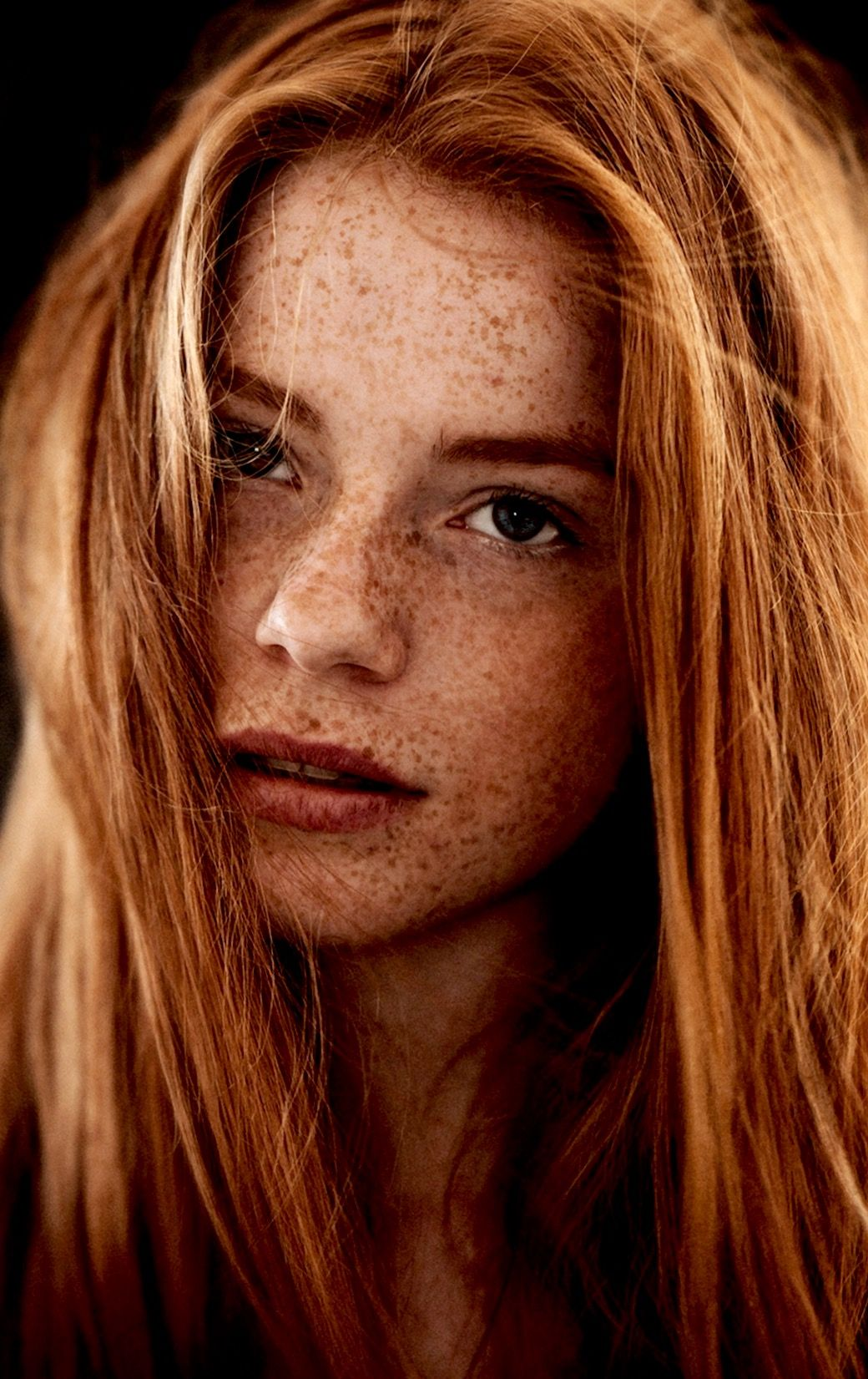What a gorgeous young woman she is! The freckles are only