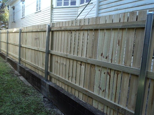 Timber Fence With Retaining Wall And Steel Posts Backyard Fences Fence Landscaping Fence Design