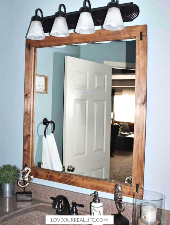 How To Build A Diy Frame To Hang Over A Bathroom Mirror Love Our Real Life In 2020 Bathroom Mirrors Diy Mirror Frame Diy Diy Bathroom