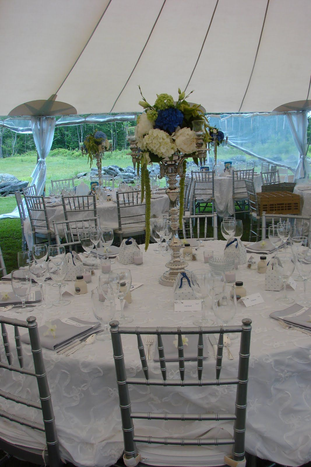 White Specialty Linen With Silver Chiavari Chairs And Silver