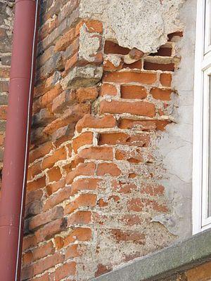 Broken Plaster Over Faux Brick Walls by Linderman Designs