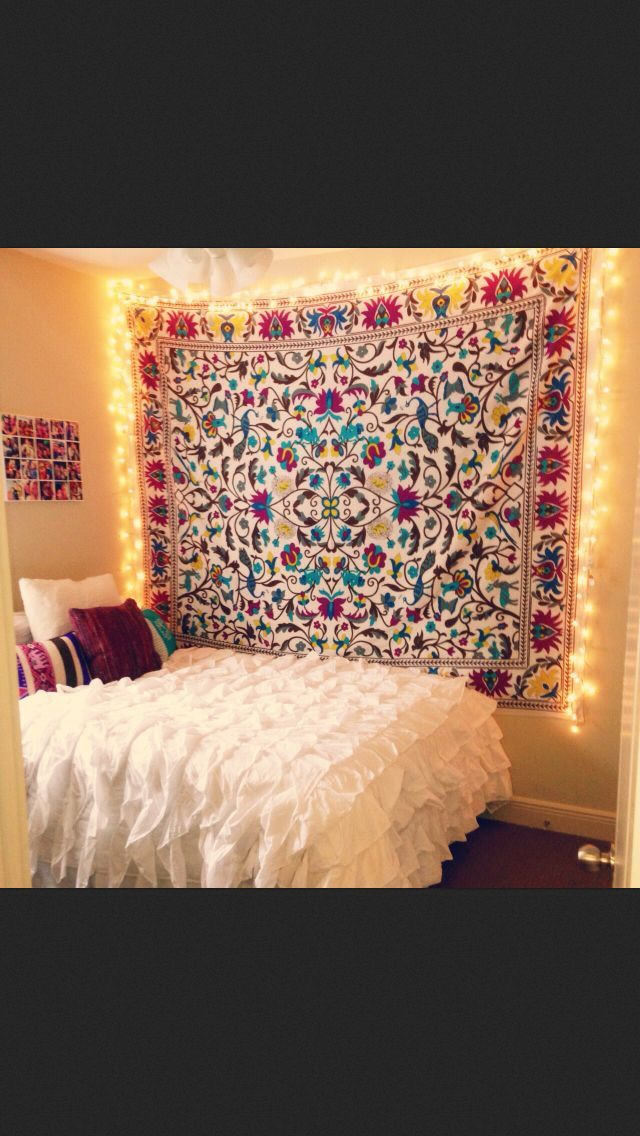 If you can't paint the walls, hang tapestries for color