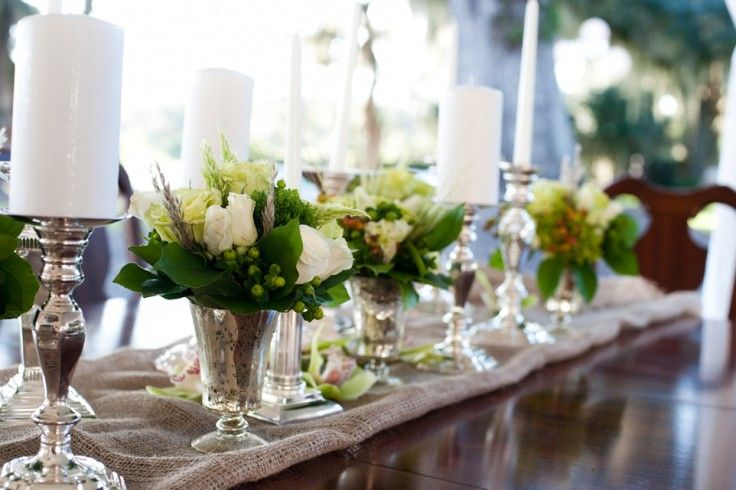 An Array Of Small White Floral Centerpieces With Candles Kiwi Fleur
