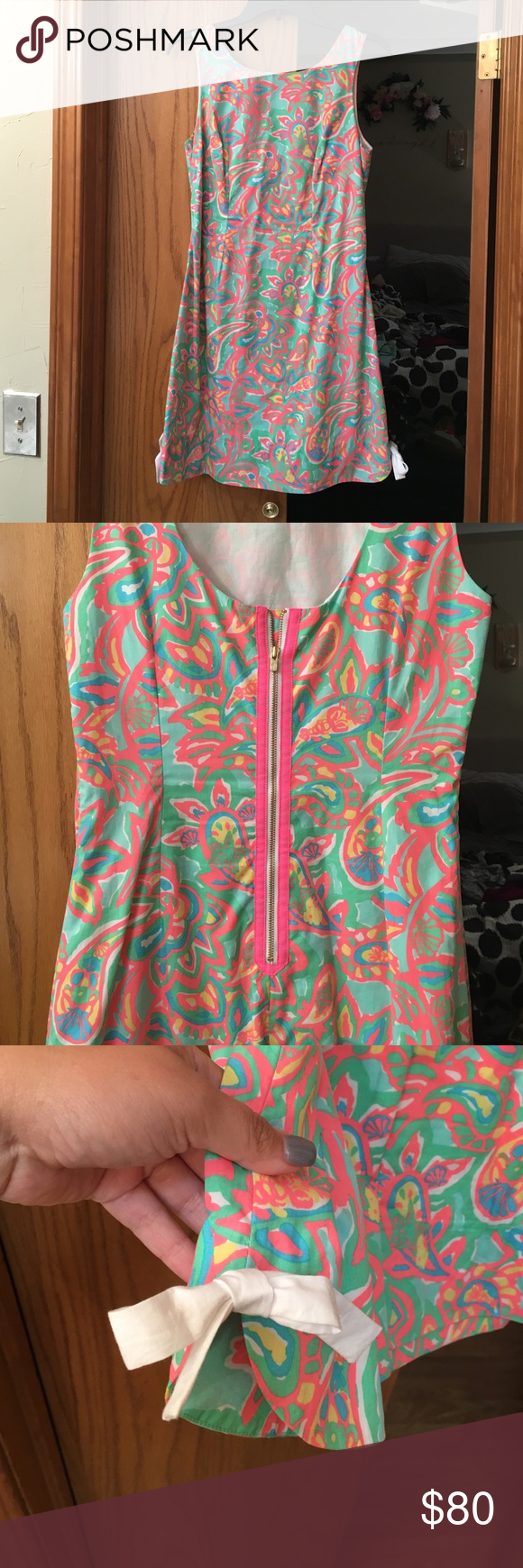 SALE🎉Lilly Pulitzer Make A Splash Adorable Lilly dress with bows on sides and exposed back zipper. Small black dots on the front (mascara?) barely noticeable and definitely cleanable. Worn once for Easter :) Priced low to get this dress to someone who will love it fast! Lilly Pulitzer Dresses Mini