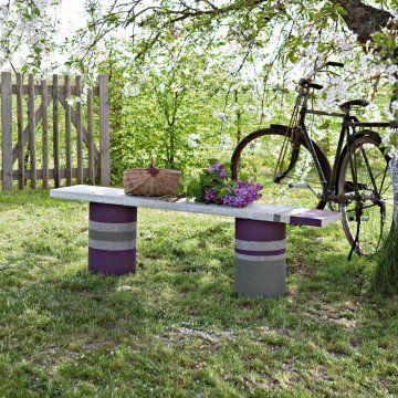 Un banc en ciment et béton Gardens