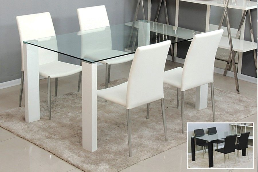 Fascinatnig Design Of Dining Table With Glass Material Plus White Chair With  Leather Sheet And Steel Legs Plus Squared Cream Area Rug With Cream Floor  ...