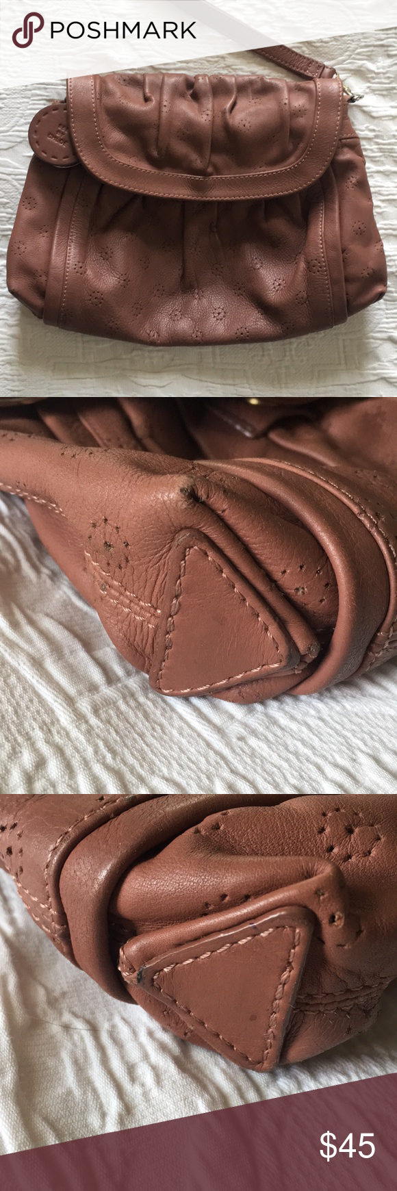 See by Chloe Clutch See by Chloe Clutch. Brownish pink color. Very soft leather. See pics for slight wear around corners and mark on inside of bag. See By Chloe Bags Clutches & Wristlets #seebychloe