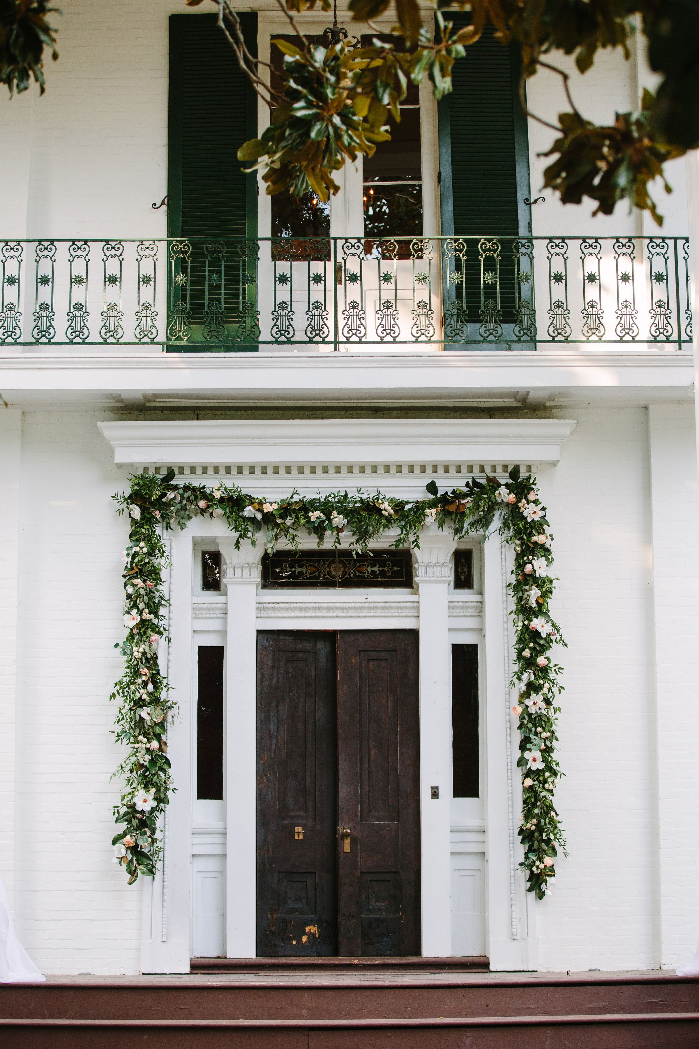 Garland and florals around the front door of the Riverwood