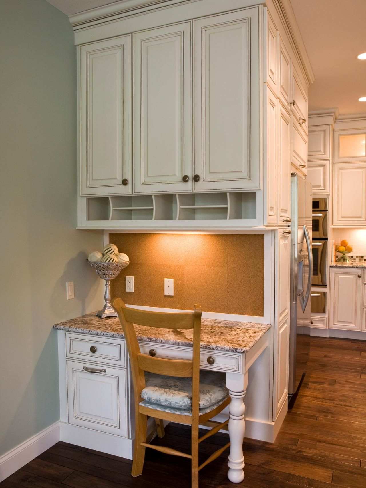 This Custom Designed Kitchen Desk Area Features Plenty Of Storage Granite Countertops And A Corkboard Backsplash