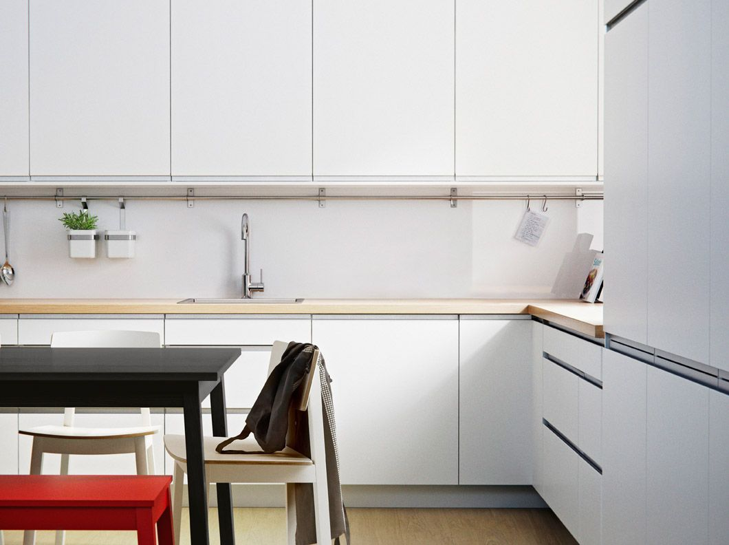 FAKTUM kitchen with ÅRSTA white doors/drawers and PRÄGEL light oak ...