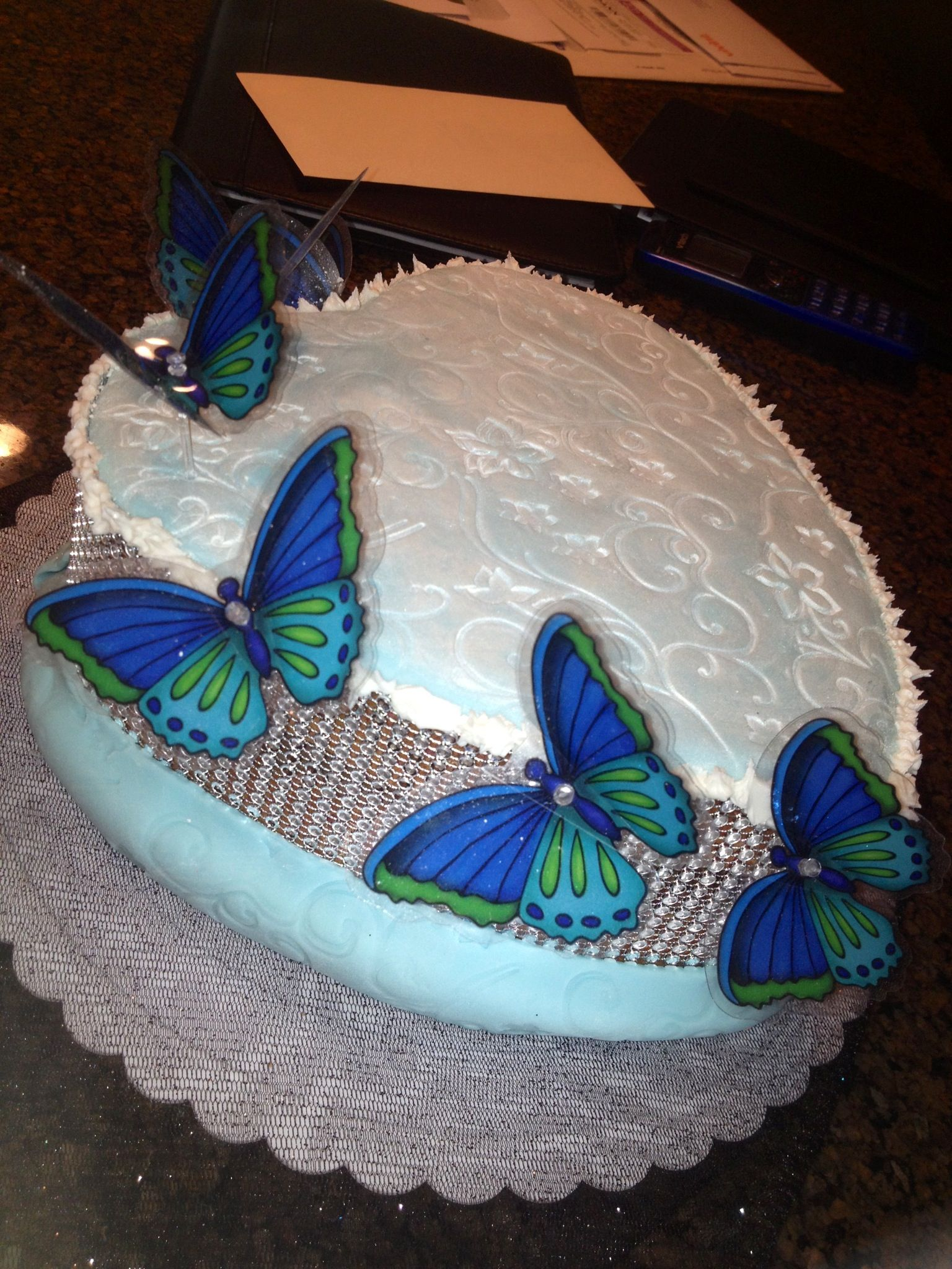 Heart shaped butterfly cake with some sparkles light blue