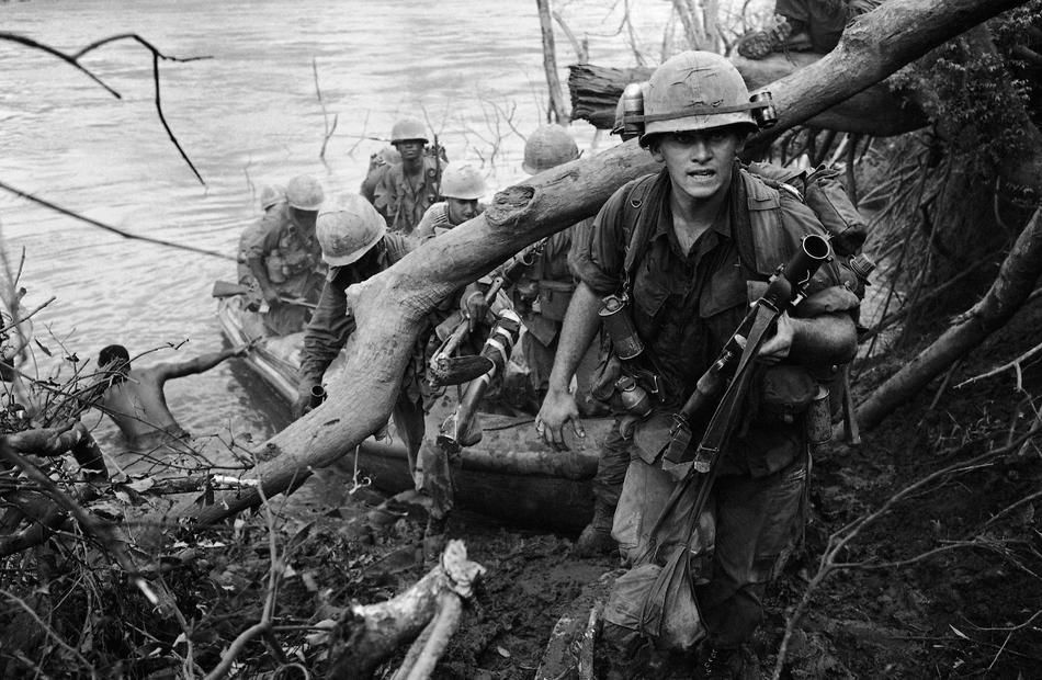 Song Be River in D Zone, 30 miles northeast of Saigon, Vietnam on Sept. 30, 1966. The 173rd Airborne Brigade began Operation Sioux City with several helicopter assaults. Boats followed the troops and an hour later a company of the 2nd Bn 503rd Infantry Airborne Brigade headed north across the 150 feet wide, fast flowing river, in rubber boats with outboard engines under cover of machine guns and air strikes. I was deployed with the 173rd on Operation Siuox City 1966.  I deployed with D16…