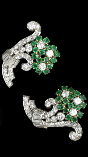 A pair of emerald and diamond flower earclips, circa 1930 Each designed as a bouquet of flowers with scrolled details, set throughout with circular-cut emeralds, brilliant, baguette and single-cut diamonds, diamonds approx. 2.05cts total, length 2.7cm